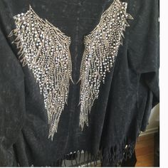 Vocal open light jacket with fringe/rhinestones Re-Poshing never worn loved it but just a bit to big for me really cool light weight jacket/cardigan with gorgeous bling out angel wings sparkling rhinestones mint condition previous posher worn it once price is firm just would like to get what I bought it for❤️it's definitely a worth the money on e bay selling for a lot more  Vocal Tops Sweatshirts & Hoodies