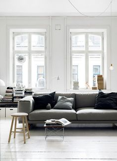 I like the double windows behind the sofa, give a lovely soft light.  The city view works well too