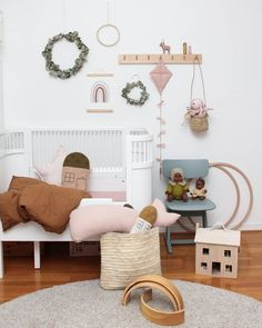 Minimalist little girls room featuring Olli Ella Holdie House