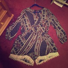 Forever 21 Romper Only warn last year for Christmas! In like-new condition! Navy blue, orange, brown, real, cream, and pinks mixed in throughout the romper. A low cut V shape front and lace on the bottom of the shorts! Forever 21 Pants Jumpsuits & Rompers