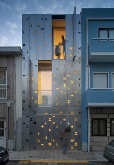 hHouse 77 with a Facade Comprising Aluminum Shutters Perforated With Symbols by dIONISO LAB