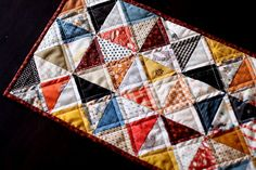 Adorable beginner's quilted table runner.  Looks good at any season when you change your colors.