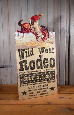 Wild West Rodeo Die Cut Sign  Great colors and detail.  Who hasn't gone to a Rodeo on July 4th?  That was a family tradition while our grandparents lived in Prescott, Arizona. Prescott hosts the oldest rodeo in the West every 4th of July. Fun and happy memories.  Measures 24 x 11 1/2 x 1/2