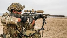 U.S. Army Ranger aims his M110 semi automatic sniper system during a marksmanship training at a shooting range in Balakh province, Afghanistan on 20 January 2014.