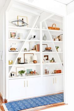 Pro tip: When trying to refresh your décor do something as simple as rearranging your bookcase to make your home feel new.