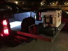 2007 Chevy Avalanche DIY bedslide with LED cargo lighting. 2007 Chevy Avalanche, Avalanche Truck, Pelican Cooler, Led Light Bar Mounts, Ford Raptor, Diy Bed, Chevy Trucks, Cool Things To Make, Chevrolet