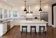 Kitchen Wonderful Kitchen Remodels With White Kitchen Cabinets L Shaped And White Kitchen Island Above Wood Flooring Around Refrigerator Making the Kitchen Remodels