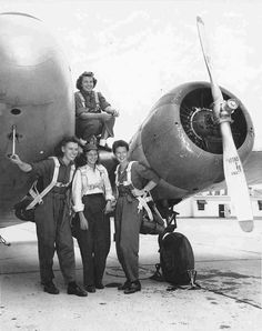 Four WASP pilots in front of a Cessna UC-78 Bobcat aircraft at Greenville AAF Greenville Mississippi United States August 1944. Deanie Bishop on the wing with Joan C Hutton Emily Porter and Phyllis M Johnson.