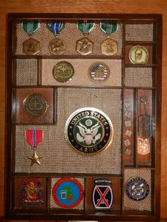 I made this new display for my fiancé's Challenge Coins, medals, and identification tags. We're thinking of having his dress uniform shirt preserved in a shadow box, so then both can hang by his honorable discharge certificate.