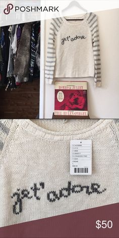 "ANTHROPOLOGIE cozy sweater Super cozy cream sweater by anthropology. Features silver stripes on the sleeves the quote ""jet' adore"" on the front of sweater. Anthropologie Sweaters"