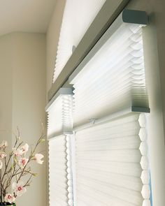 Impressively energy efficient, Applause® Duolite™ honeycomb shades combine two fabric opacities in one shade.  A sheer fabric to gently filter the light, and a semi-opaque or opaque fabric for enhanced light control, privacy and energy efficiency. ♦ Hunter Douglas window treatments
