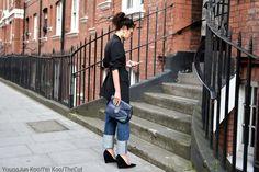 Shop this look on Lookastic:  https://lookastic.com/women/looks/blazer-boyfriend-jeans-wedge-pumps/13744  — Black Vertical Striped Blazer  — Black Elastic Waist Belt  — Navy Leather Clutch  — Blue Boyfriend Jeans  — Black Suede Wedge Pumps  — Gold Earrings