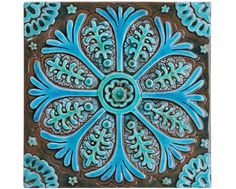 Suzani wall art made from ceramic.    This Suzani wall hanging was carved in deep relief and no two pieces are exactly alike making each one truly unique.