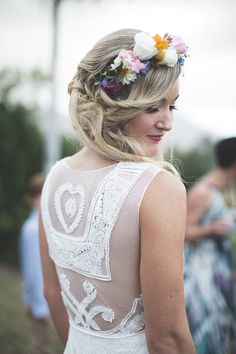 Jane Hill wedding dress with lace mesh detail and a blonde bride with flowers in her hair.