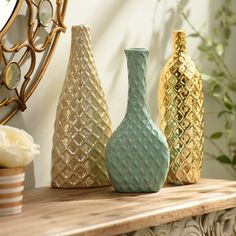 These Diamond Embossed Metallic Vases are even better together than they are apart. Available in turquoise, gold and pearl, these vases are the perfect accent for a console table or bookshelf. They add a metallic shine and show off your glamorous style.