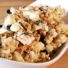 This tasty snack mix is a combination of rice cakes, pretzels, cereal, nuts, dried fruit and sweet white chocolate. Keep some around the house for movie nights or package it in tins for an easy holiday hostess/host gift. Holiday Baking, Christmas Baking, Christmas Fun, Cake Mixture, Rice Cakes, White Chocolate Chips, Yummy Snacks, Popcorn