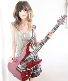 Guitar girl Jacqueline Mannering. (and yes, she IS over 18; she's older than she looks :p )