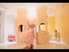 VIDEO of HOMEMADE CARDBOARD PRINCESS CASTLE and the LITTLE PRINCESSES AT PLAY -- This castle hosted plenty of tea parties and baby doll nap times. The drawbridge was used a lot by the 3 yr old to keep her 1 yr old sister out......... glad I didnt put a lock on the castle door. ;) Heres a video of the cuteness in action