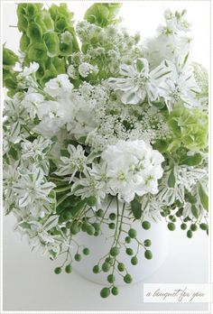 Love this green/white bouquet. Note to self: Belles of Ireland, Variegated Euphorbia, White stock or Snap dragons.