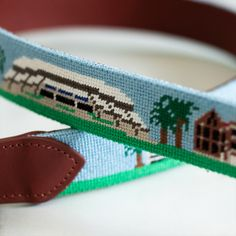Gator Needlepoint Belt Canvas with floral accents on teal background
