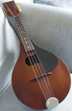 Get my great-grandmother's mandolin restored and take lessons on how to play it--this is beautiful!!
