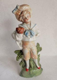 statuette en porcelaine, petit garçon portant son chien, K 1292