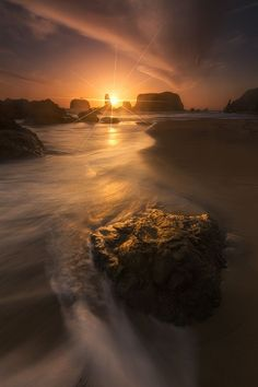 ~~Turn | sea stacks lit by at sunset forms a perfect starburst at Bandon Beach, Oregon | by John Canlas~~
