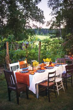 Mismatched chairs and a welcoming picnic table is the perfect setting for a meal outdoors. Photo by TJ Turner