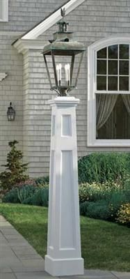 "Seaside Pillar Post - No matter your location, this lantern post is sure to add dignity and charm to your landscape. Tapers from 12"" sq. at the bottom up to 8"" sq. at the top. 84"" H. Crafted from cellular vinyl, a wood-alternative and prefinished white. Motor freight. Shown with a Tiverton lantern."