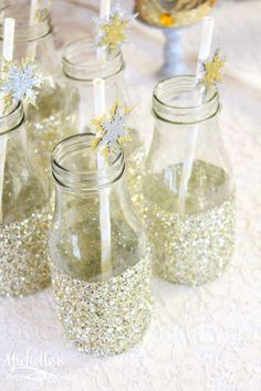 Sparkly milk bottles at a Christmas party! See more party planning ideas at CatchMyParty.com!