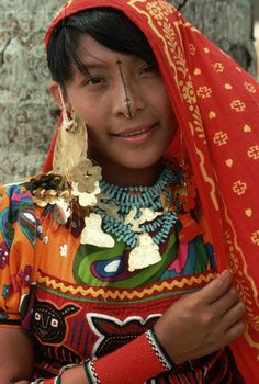 Panama | A brightly dressed young Cuna girl with a pierced and painted nose. San Blas Islands. | © Adam Woolfitt
