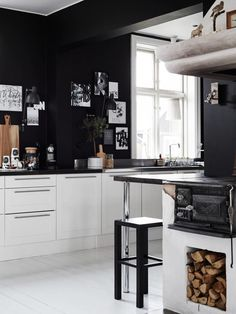 Ylva Skarp's home. White kitchen with black walls