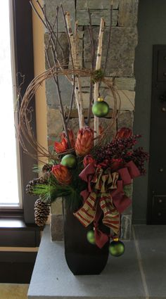 natural new take on the traditional holiday arrangement. Christmas Urns, Christmas Planters, Christmas Flowers, Outdoor Christmas Decorations, Country Christmas, All Things Christmas, Christmas Holidays, Christmas Crafts, Holiday Decor