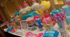 Blue and pink and yellow candy table