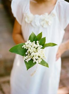 A sweet, simple Lily of the Valley posy bouquet for a flower girl | Brides.com
