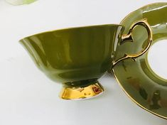 Elizabethan Princess teacup and saucer. No chips, crazing or gold loss. Both pieces ring nicely. Gorgeous set with large cabbage roses. Olive green saucer and teacup. Just beautiful. Please look at photos carefully as they are a part of my description. Note. Actual color may differ