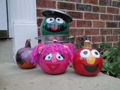 """Sesame Street Pumpkins (2010) & our 3 year old painted """"Ernie"""" in the back"""