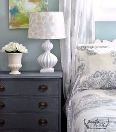 gray dresser love how it looks against the blue walls!