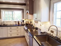 Cabinets In White And Cabinets In Gray Come Together To Create A Beautiful  Kitchen In Santa