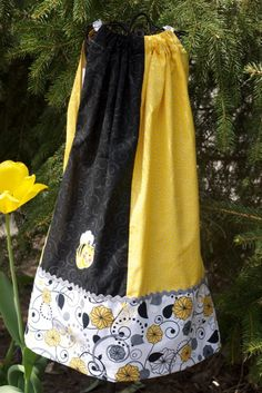 Cute little bee appliqued Pillow Case Dress. Single back tie. Pair this with a long sleeve top and ...