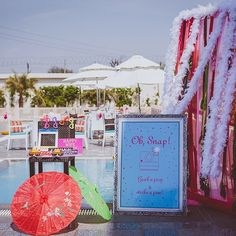 Grab a prop and strike a pose! Pinky and Hemant got a quirky photobooth along the poolside at their destination wedding at Golden Tulip, Neemrana. Indian Wedding Theme, Indian Wedding Photos, Indian Wedding Decorations, Wedding Blog, Destination Wedding, Bride Groom Poses, Mehndi Party, Pool Party Decorations, Wedding Photo Booth