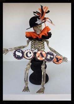 A crazy 6 inch skeleton is all ready for Halloween with his scary banner. He is wearing a felt hat with a crepe paper plume and a silver glittered star. Halloween Trophies, Creepy Halloween Decorations, Halloween Ornaments, Halloween Trees, Halloween Skeletons, Halloween Party Decor, Holidays Halloween, Halloween Miniatures, Halloween Doll