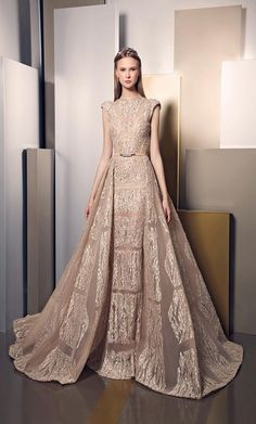Ziad Nakad Summer 2016| Nude gown with different kind of fabric on the skirt.