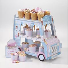 Street Stall Ice Cream Van A super cute Ice Cream Van Stand with 3 tiers. Add ice creams and treats, sweets and cakes or fill the paper cones with sweets. Card van stand pack includes 12 x paper ice cream cones, 'A' board sign and stickers to personalise. Ice Cream Stand, Ice Cream Cart, Décoration Candy Bar, Décoration Baby Shower, Candy Stand, Ice Cream Social, Paper Cones, Food Stands, Party Shop