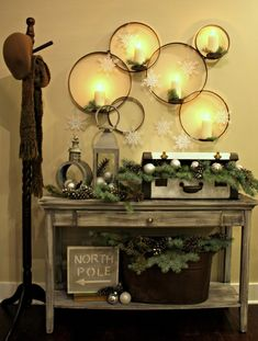 Pretty Christmas Decor-would love this in my entry way.  Embroidery hoops hung on the wall.