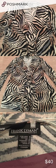 Zebra cardigan Zebra cardigan with ruffle front by Frank Lyman. Made in Canada. NWOT from a boutique. Size 8. Frank Lyman Sweaters Cardigans
