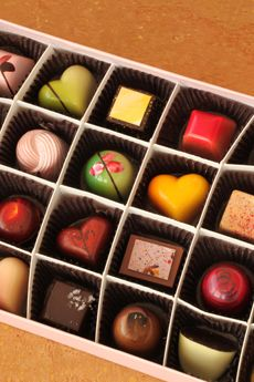 """I think this would be such a cute idea for a wedding. Have boxes of chocolates on the tables with """"Life's like a box of chocolates..."""" On the outside and under each piece, a lovely small quote, poem, saying, """"Did ya know"""" facts of bride & groom, etc...   Anna Shea Chocolates"""