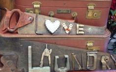 Signs made on old saws and rusty tools...