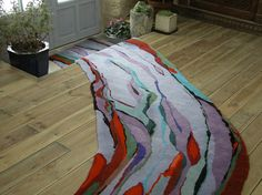 'River rug'.I made this rug for a curved hallway. I wanted to create a feeling of fluid lines following the course of the corridor. Hand tufted rug by Annette Turner. This section of the rug measures 84cm by 530cm.
