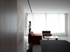 At the top of the building, the sixth storey is designed for entertaining guests. Here there is a second large living and dining space connected to a rooftop terrace, children's playroom and guest bedroom. Living Area, Living Spaces, Living Room, Minimal Home, Family Room, Home And Family, Brick Cladding, Box Building, White Tiles
